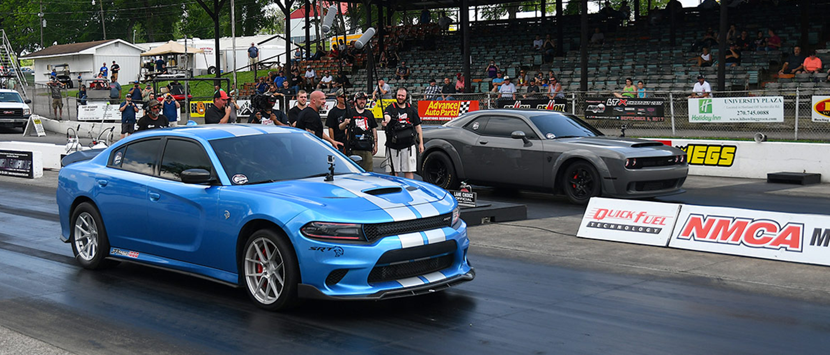 Blue Hellcat racing a gray Demon