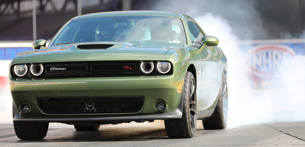 F8 Green 1320 Challenger Drag Pak launching off the start line on the drag strip