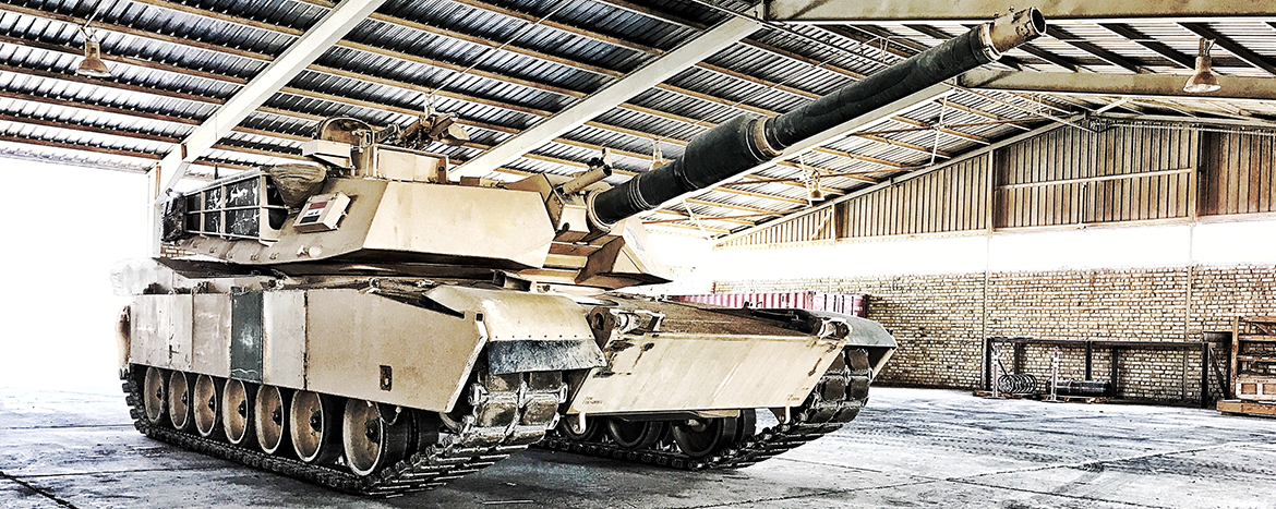 Abrams tank parked in a garage