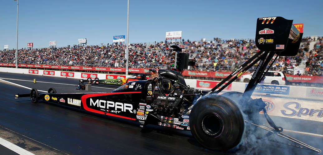 Leah Pritchett racing down the track in her Dodge Mopar Top Fuel dragster