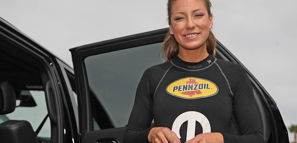 Leah Pritchett sanding outside of her Durango SRT
