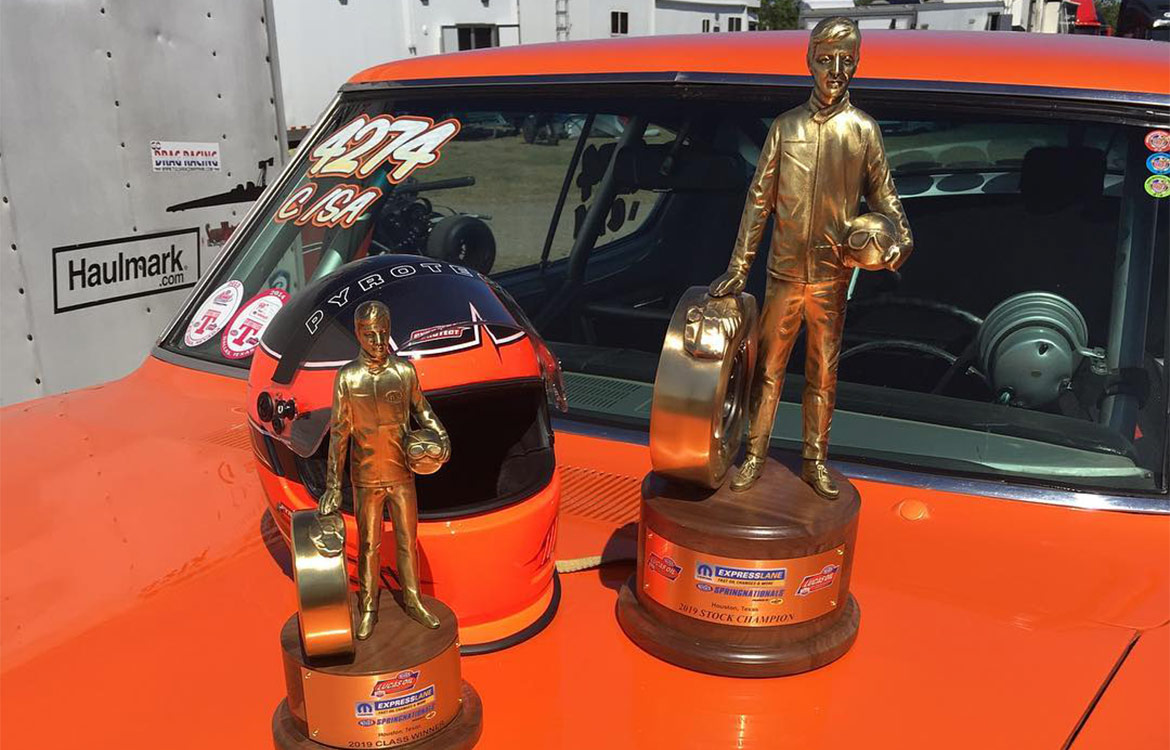 Sportman trophies on the hood of an orange HEMI Challenger