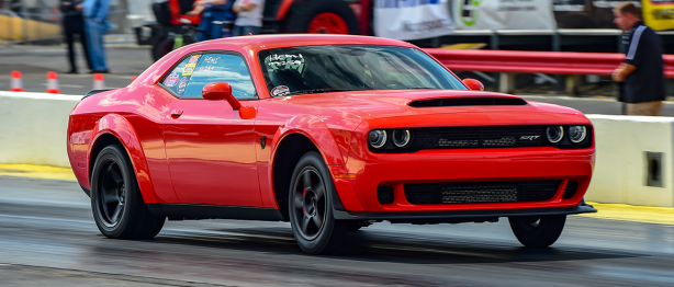 Red Challenger racing down the track