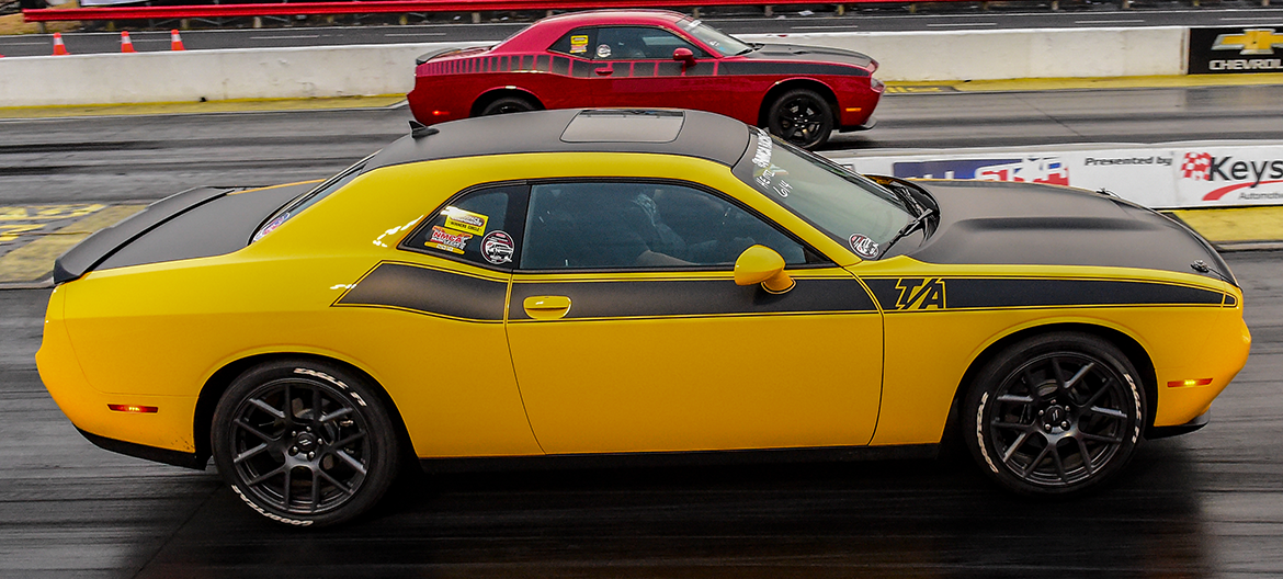 Yellow Challenger TA racing a red Challenger TA