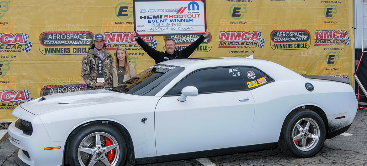 2018 HEMI Shootout All-Star Nationals winner Phillip Bridges posing for a picture behind his white Challenger Hellcat