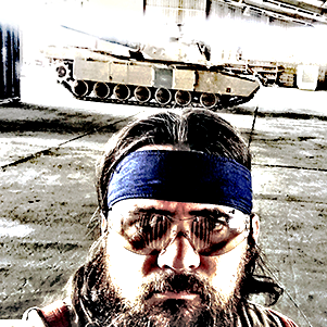 Josh Welton standing in front of Abrams tank
