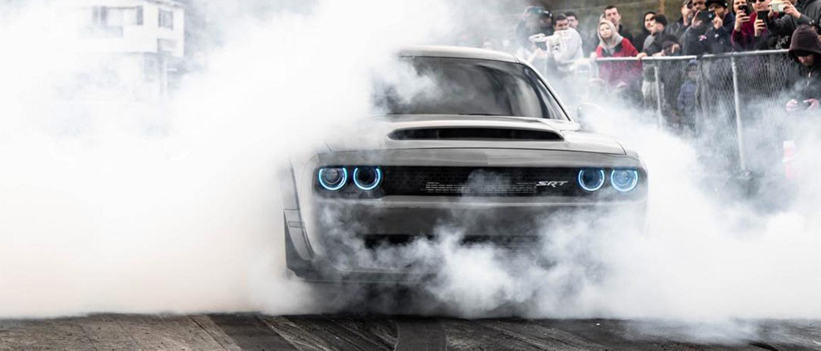 Gray Dodge Demon doing a burnout