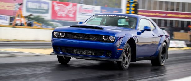 Blue Challenger SRT racing down the track