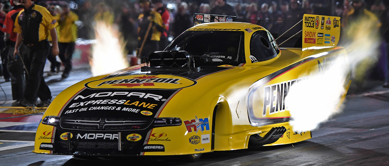 Matt Hagan racing down the track in his Dodge Charger SRT Hellcat Funny Car