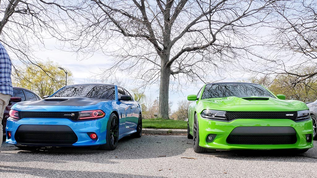 Two Dodge chargers parked next to eachother