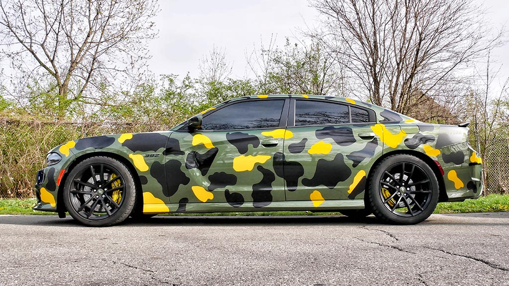 Side view of a Camo Dodge Charger Daytona