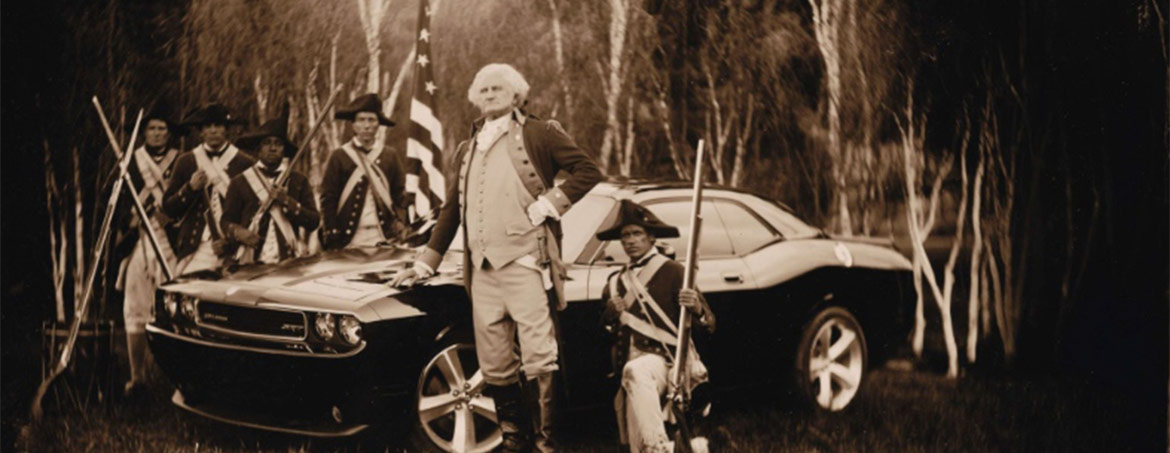 George Washington and his soldiers standing next to a Dodge Challenger