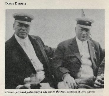 Horace and John Dodge sitting on a boat with sailor caps on