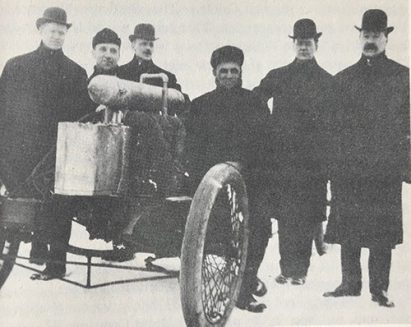 Henry Ford with his early race car. John Dodge all the way on the left.