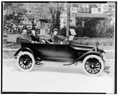 Horace & John Dodge being driven in the very first Dodge Brothers car, 1914