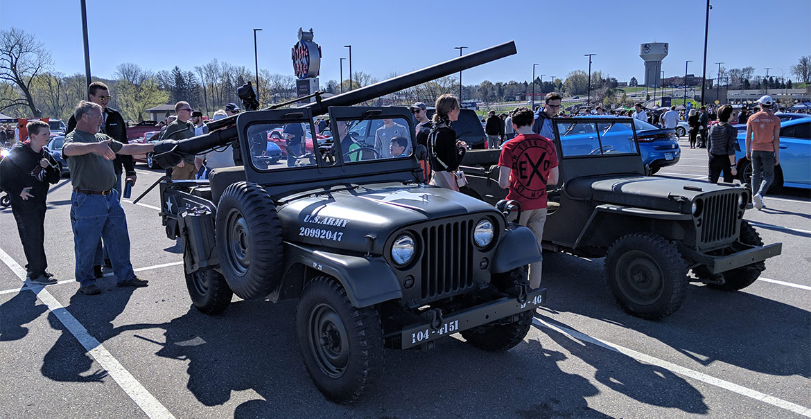Jeep military vehicles with a crowd around