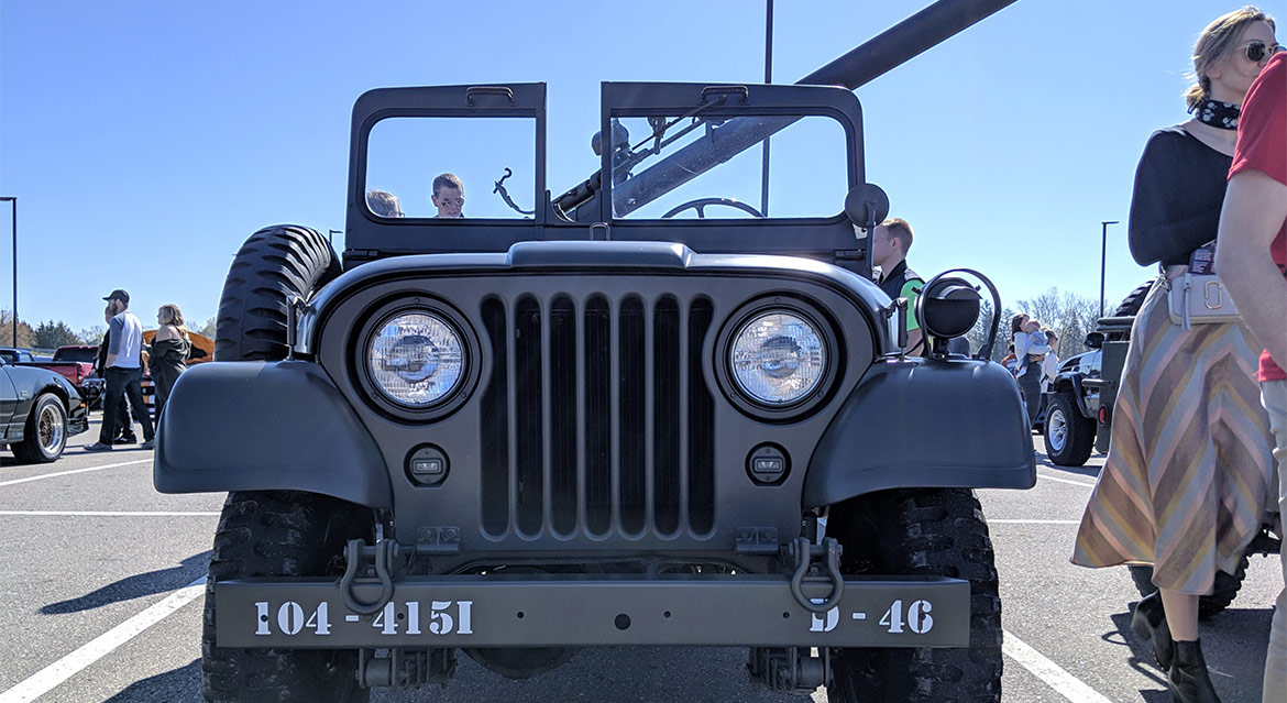 front of a Jeep military vehicle