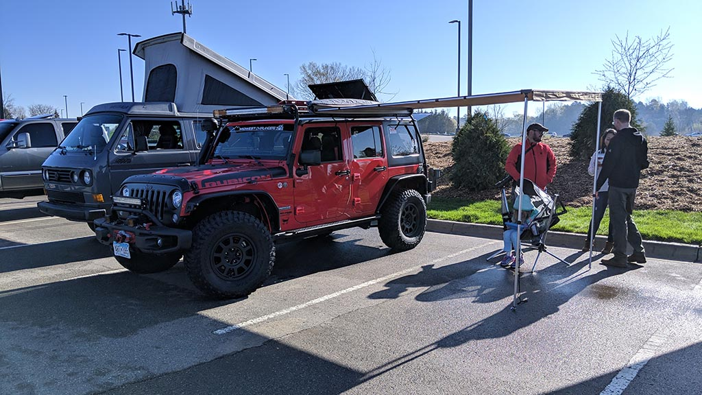 Red Jeep Rubicon with tent at Cars & Coffee Minnesota