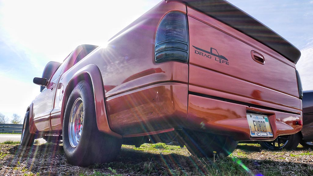 Tail gate of orange Dodge RAM