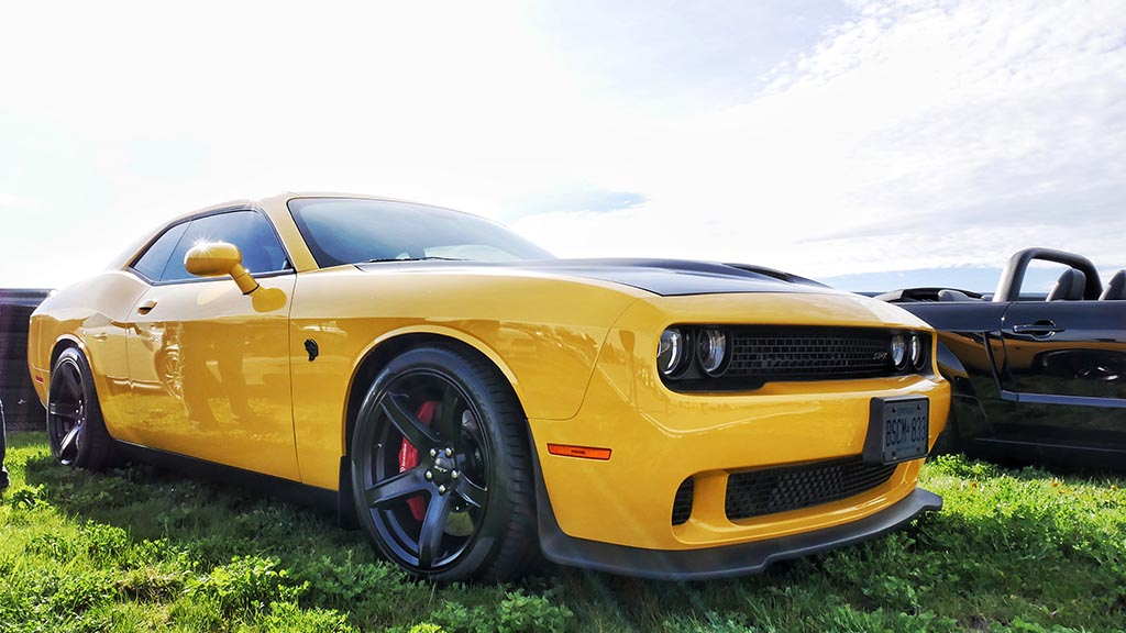 Yellow Dodge Challenger Hellcat with matte black hood at M1 Cars & Coffee