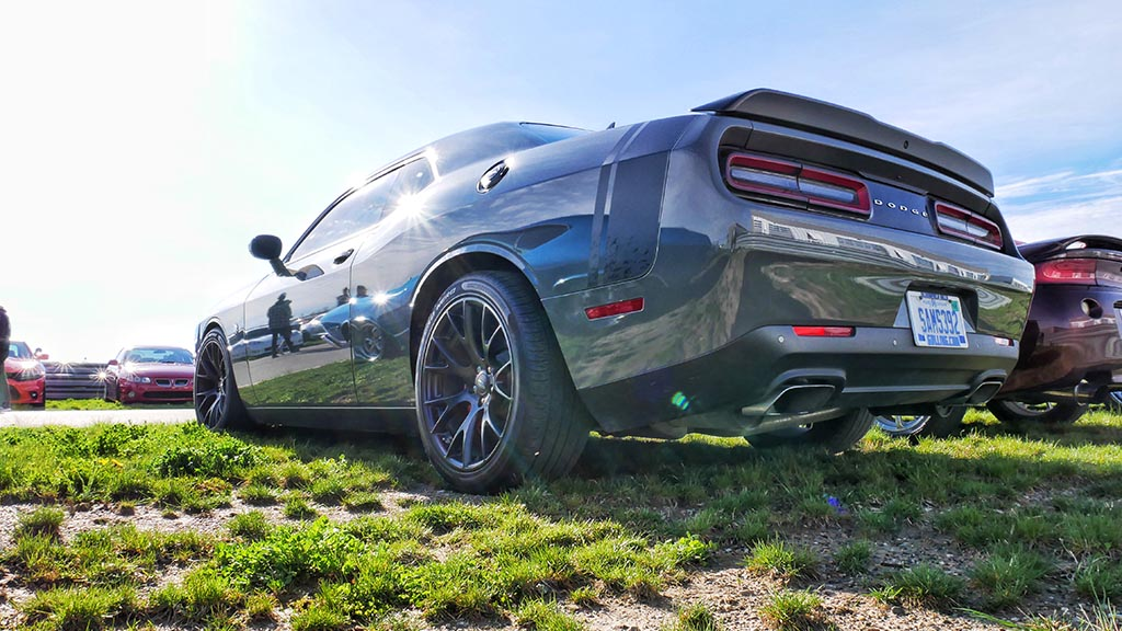 Gray Dodge Challenger with matte black stripe