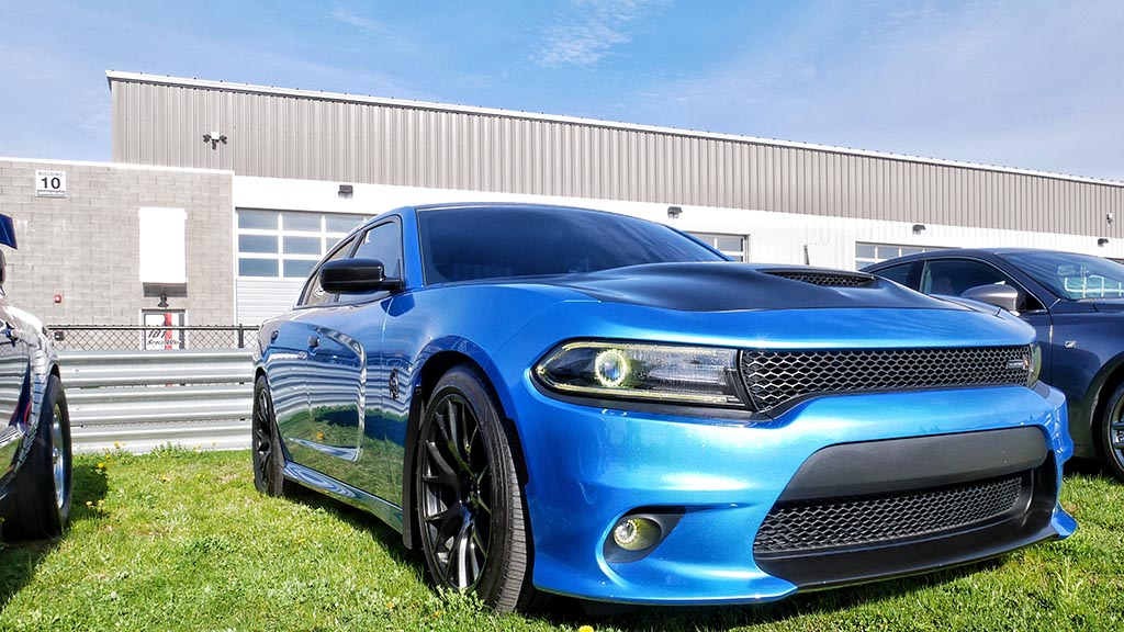 Blue Dodge Charger with black stripe at M1 Cars & Coffee