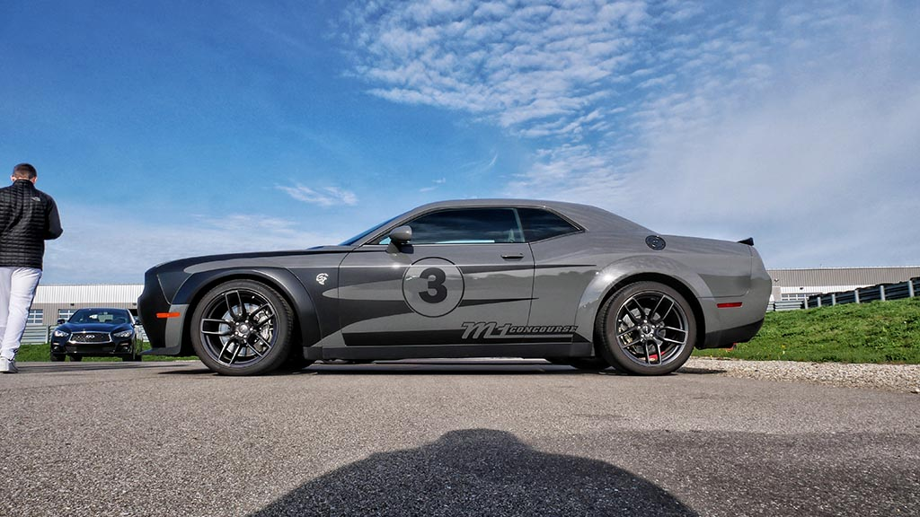 Side view of gray Dodge Challenger SRT Hellcat M1 Concourse car