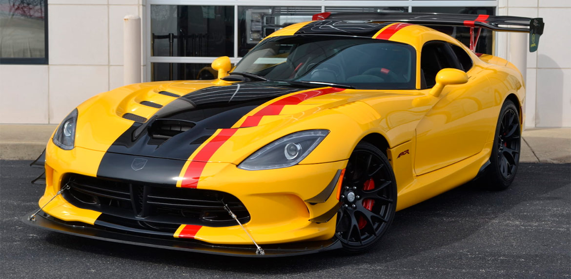 Yellow 2016 Dodge Viper ACR with black and red racing stripes