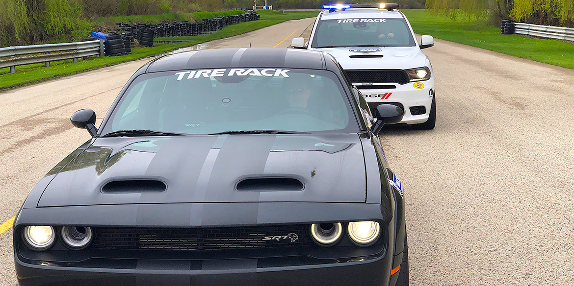 One Lap of America Durango SRT Pursuit pulling over a black SRT Hellcat Redeye being driven by Mike Musto