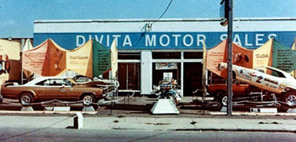 The front of a dealership with the RTS on display