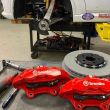 Set of red Brembo brakes sitting on a table waiting to be installed on the Durango SRT Pursuit