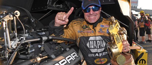 Ron Capps holding up his Wally trophy after winning the NHRA Virginia Nationals