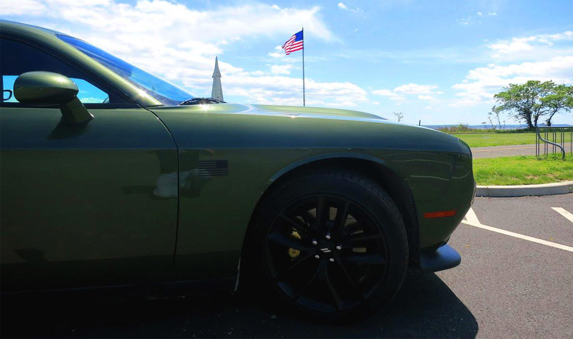 Dodge Challenger Stars & Stripes edition with American flag in the background