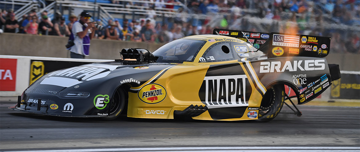 Napa Auto Parts Dodge Charger Hellcat Funny Car racing down the track
