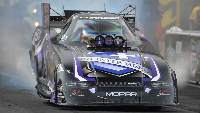 Jack Beckman's Infinite Hero Dodge Challenger Hellcat Funny Car racing down the track