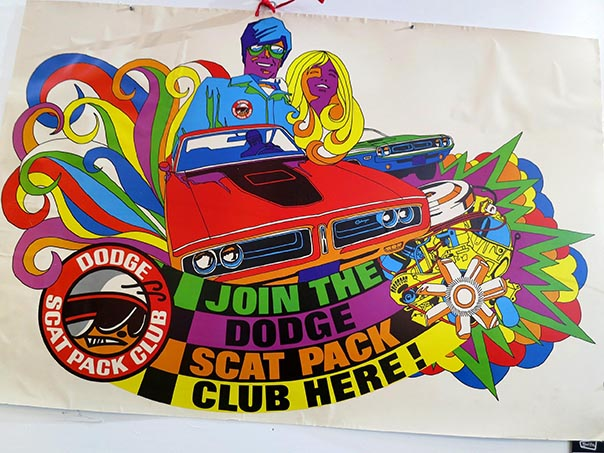 70's retro poster reading,'Join the dodge scat pack club here!' with an old cars and couple coming out of the top.