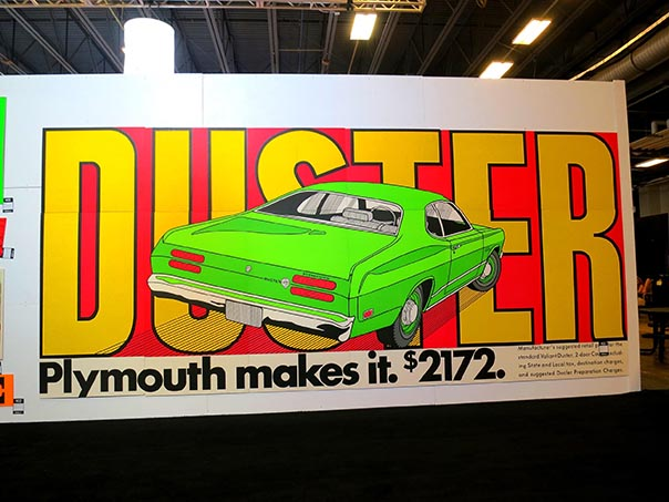 Wall size poster of a Plymouth Duster reading 'Plymouth makes it. $2172.'