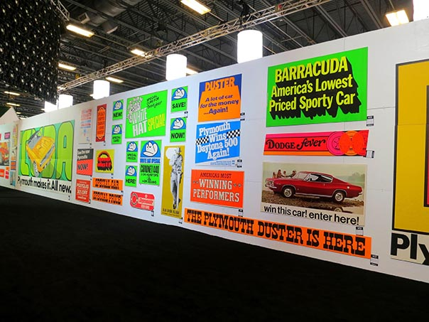 Wall of Dodge, Barracuda and duster memorbilia posters.