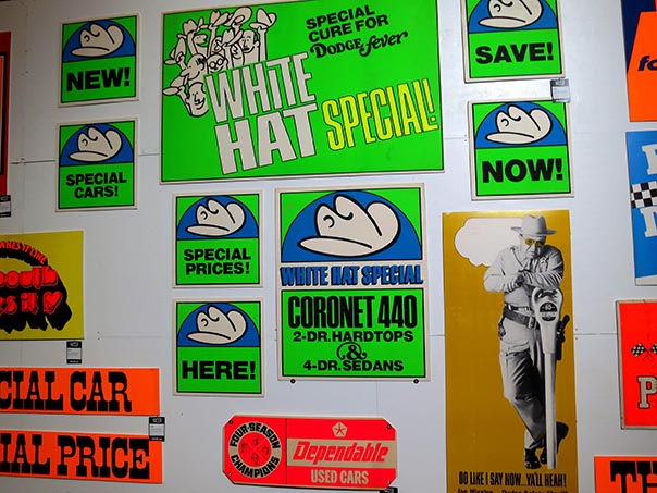 Neon green posters from the Dodge white hat special.