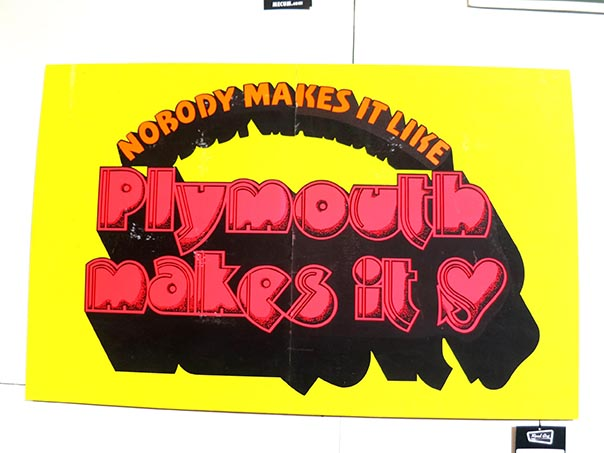 "Older 70's sign reading ""Nobody makes it like Plymouth makes it"""