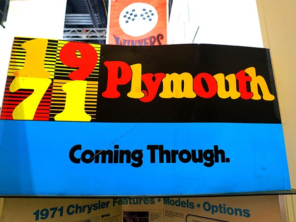 1971 Plymouth coming through sign.