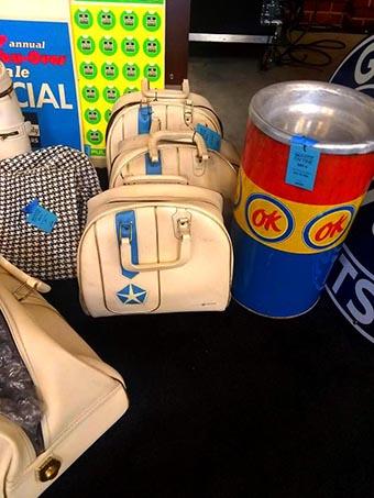 Three white plymouth purses.