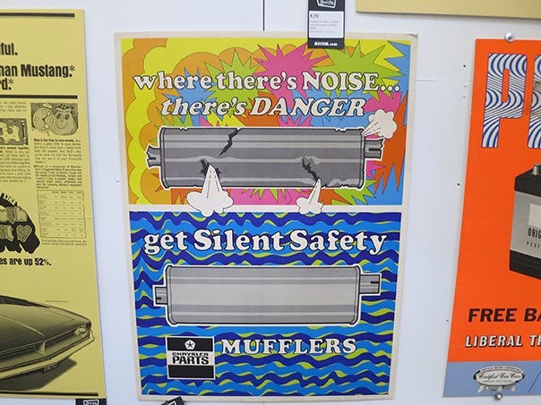 "Chrystler n parts poster reading ""where there's noise... there's DANGER get Silent Safety mufflers""."