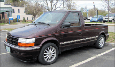 a dodge caravan minivan turned into a pickup