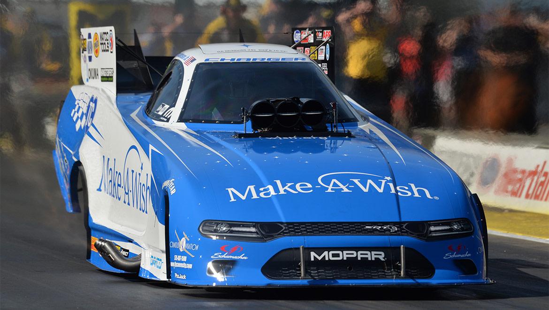 Tommy Johnson Jr racing his Make A Wish Dodge Charger SRT Hellcat Funny Car at NHRA Heartland Nationals
