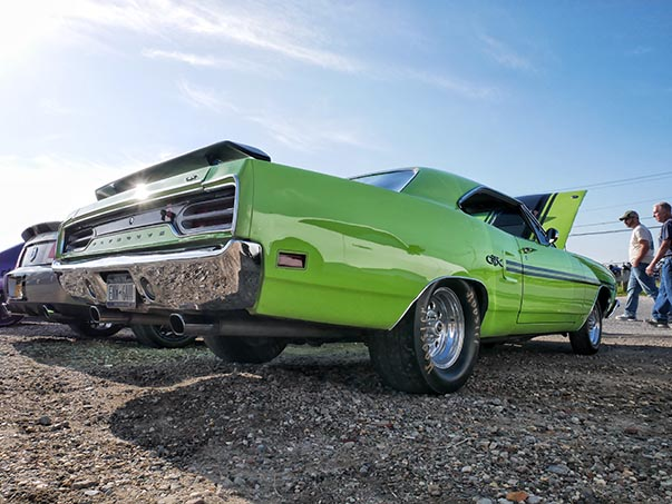 Side view of green Plymouth GTX