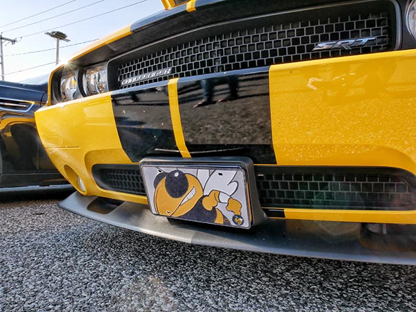 Front end of a yellow SRT Scat Pack Challenger