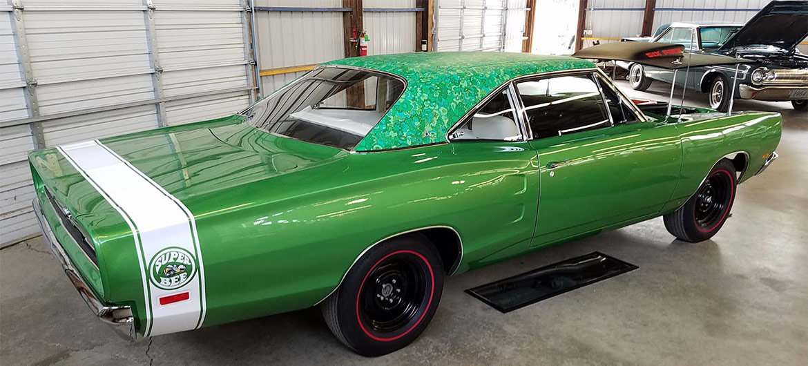 Green mod top Super Bee on display at Mopars in the Park