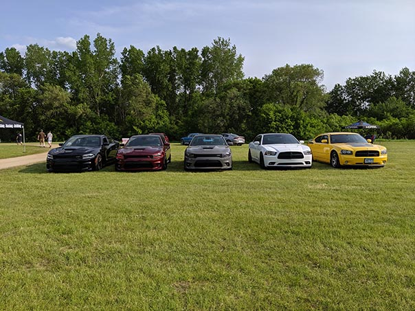 Row of Chargers on display at Mopars in the Park