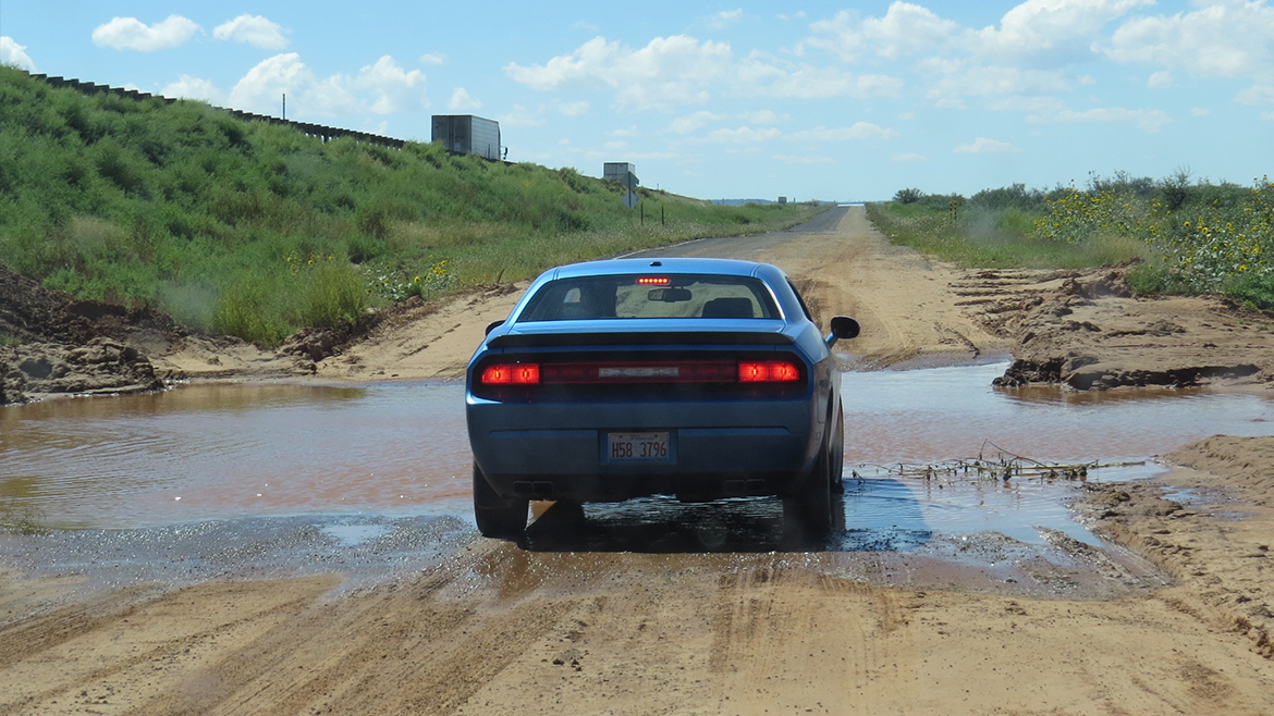 a 2009 Challenger R/T Classic in B5 Blue on a dirt road